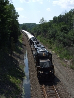 eastbound from Port Jervis with the circus train coaches passes the the cow bridge along route 211 north of Middletown