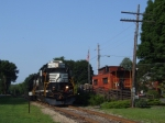 Circus train power on the Wallkill line passing the town caboose