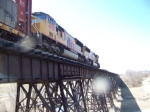 UP 4908 with vehicle train blasting over the trestle bridge