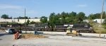 108 - Broadside shot of NS train 12R passing dozer spreading stone for new storage track at Kemper Street Station
