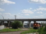BNSF northbound passes underneath new DART greenline elevated station