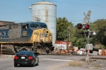 Car driver prudently waits for CSX 232 to clear the crossing