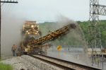 LORAM Shoulder Ballast Cleaner at work near Reusens