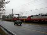 Northbound GNRR grain train on a rainy afternoon