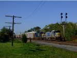 CSX 7509 in stealth paint leads going east