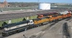 A BNSF MP15DC switcher moving some SD70MACs at Mpls MN Northtown yard in May 2011.