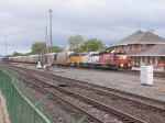 CP 5965 and 2 CITX lease units head east by the depot with 36T