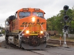 BNSF 6229 leads 665 by the eastbound signals at Main St