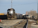 NS 5181 switches cars at the west end of the yard as an autorack train waits