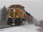 BNSF 9911 brushes a dusting of snow off the rails as it leads N903 east