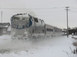 Caked in snow, 127 brings up the rear of 351