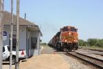 Fresh re-crewed BNSF grain train rolls past the depot