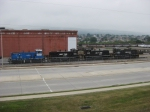 Four NS switchers (3 SW1500s and a MP15DC) sit near the main road past Juniata shops