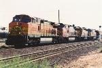 Westbound grain train curves through Kern Jct.