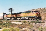 Westbound stack train eases down Cajon Pass