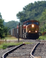 BNSF 8870 hauls an eastbound coal load past the abandoned siding switch