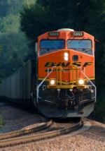 BNSF 5869 works a westbound hopper down grade on the Creston Sub