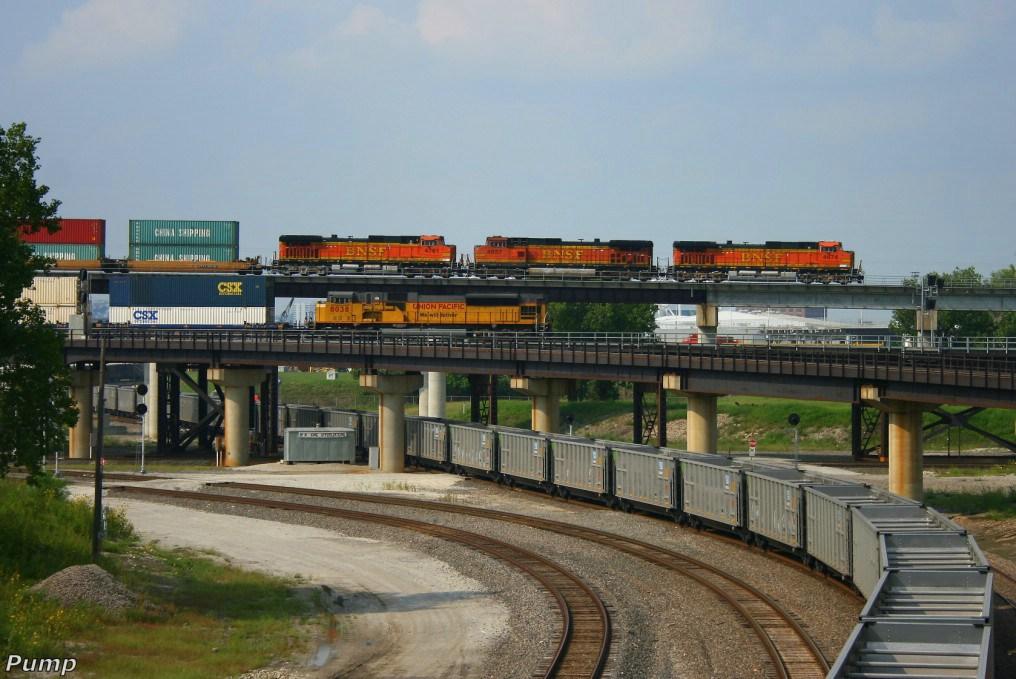 Eastbound BNSF Intermodal Train Passing Over a Westbound UP Intermodal Train DPU and a Northbound BNSF Empty Coal Train