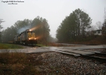 KCS moves DODX empties into Fort Polk through the south leg of the wye on a foggy day.