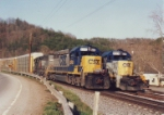 CSX 6770 and 8242 flying past the parked SD40s`