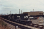 NS 3286 and 6094 pulling a train past the shops