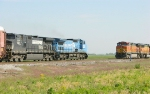 NS 8380 and 9211 passing BNSF 5039
