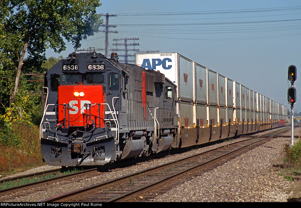 SP 6836, EMD SD45T-2 tunnel motor and a GP60 lead a short APC stack train southbound on the UPRR at Thorton Junction