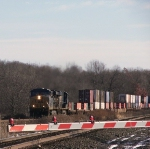 A westbound intermodal heads for the Cobblestone Road Crossing