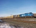 An Ex-Conrail C40-8W is on the point of this Q254 train
