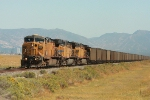 UP 6762 heads up 125 loads of PRB coal westbound