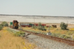 You can see the entire length of this westbound pull-push stack train