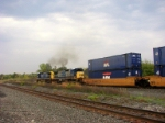 Two smokey C40-8's throttle up and head westbound 
