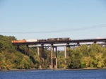 CSX #681 leads an eastbound over the Alfred H. Smith Memorial Bridge