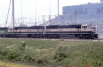 Back then brand new and clean SD70MAC leading coal train