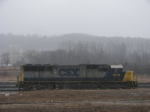 CSX #8719 idling away in heavy rain at the west end of Selkirk Yard (CP-FB)