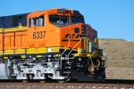 BNSF 6337 with the new automatic decoupler attached to the train and the knuckle.
