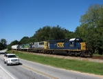 CSX 8128 leads the funeral train out of town