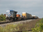 X500-26 rolls through the siding behind CEFX 1028 after meeting Q335