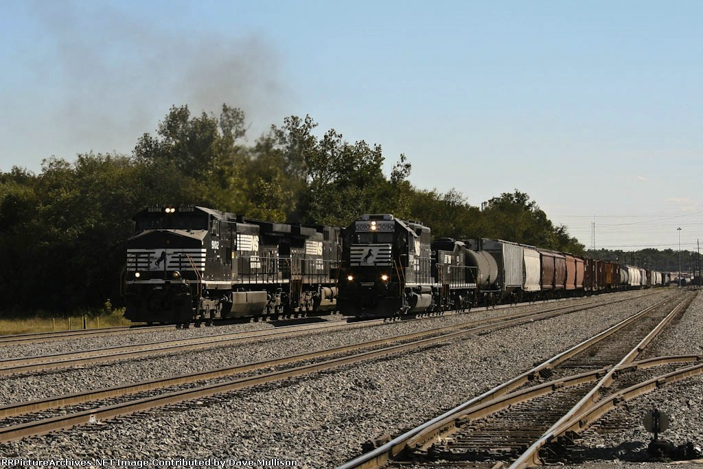 NS 9102 and 9240 lead outbound train by waiting yard units