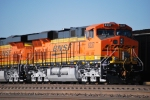 BNSF 6337 with the new automatic decoupler and her sister BNSF 6339 wait to push loaded coal train beside them.