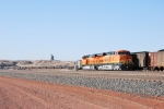 BNSF 6337 with its automatic decoupler attached to the front with BNSF 6339 as the lead unit and the Belle Ayr Mine in the background.