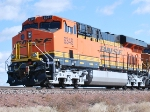 A very Brand new GEVO BNSF 6349 rolls east as the sun glistens off her new BNSF Swoosh Logo!!!
