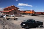 BNSF 7335 hustles an eastbound manifest past the stuccoed Vaughn, NM depot