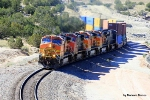 Eastbounder emerges from Abo Canyon led by BNSF 4370
