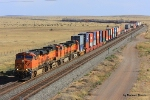 Westbound stacker led by BNSF 7477 approaches the US 60/54 overpass at Vaughn, NM