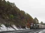 NS 6316 pushes on the rear of a mixed freight through the fall colors