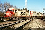 Soo 701 on Alco FA-1 trucks Crossing BN tracks at Soo Tower