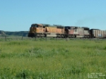 BNSF 8808 SD70MAC and BNSF 8246 SD75M hauling coal drag past Fort Keogh