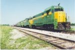 CAGY 808 leads Greenville-Columbus train on KCS (Midsouth) at Artesia in 1994