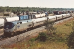 "Eastbound ""Downeaster"" eases past yard"
